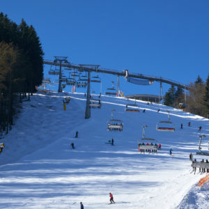 Six seater chairlift over a piste at Ski Carousel Winterberg